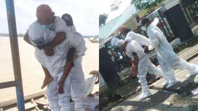 demi nyawa, petugas indonesia gendong pesakit covid-19 ke hospital, rentas sungai dengan perahu