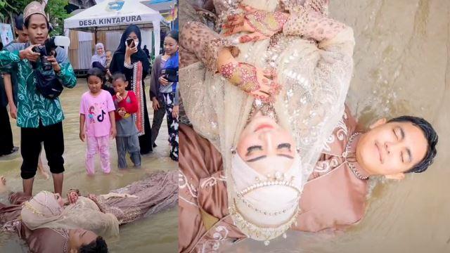 hari perkahwinan dilanda banjir, pasangan pengantin baru 'sporting' je bergambar!