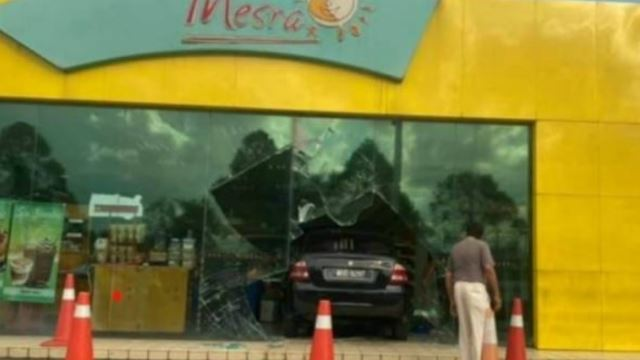 Woman Accidentally Crashes Car Into Petrol Station Convenience Store