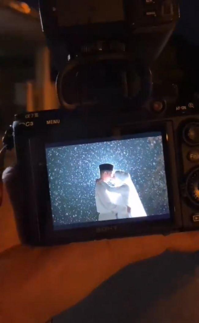 couple puts rainy season to good use in outdoor wedding photoshoot