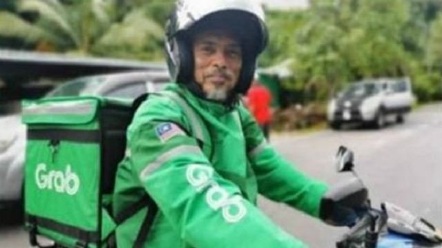 Headmaster Doubles As Grab Rider To Raise Money For School Project