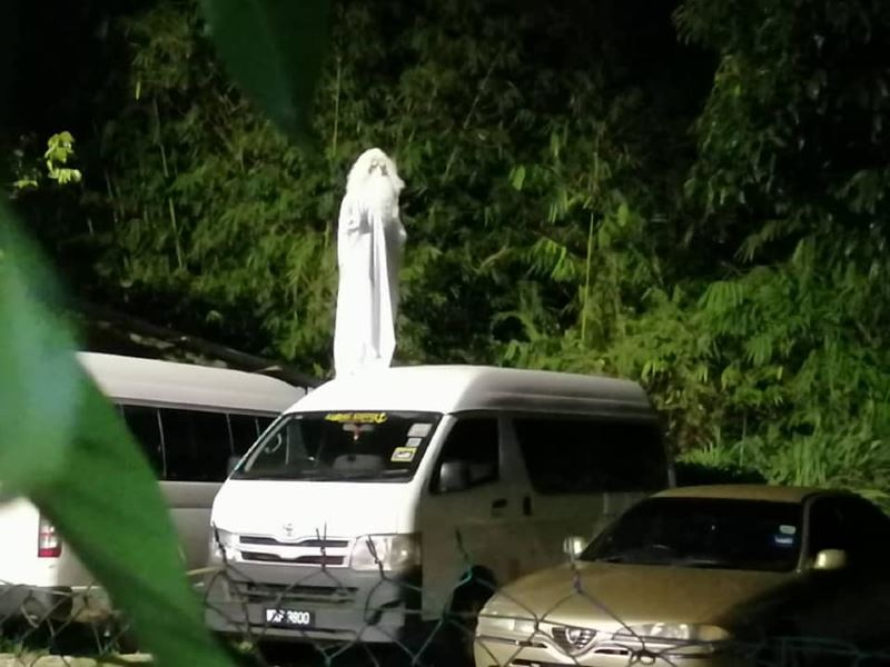 man dressed as pocong joins police's effort to keep us at home