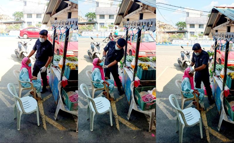 netizens praise abang polis for helping a mak cik put on a face mask and not summoning her!