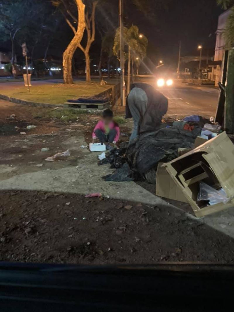 father from kedah rummages through dumpster to find old boxes to sell