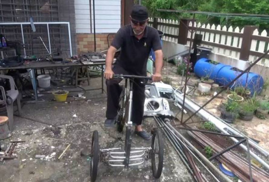 disbaled man from terengganu builds disabled-friendly bicycle out of recycled materials for himself
